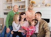 medium-shot-happy-family-couch (1).jpg