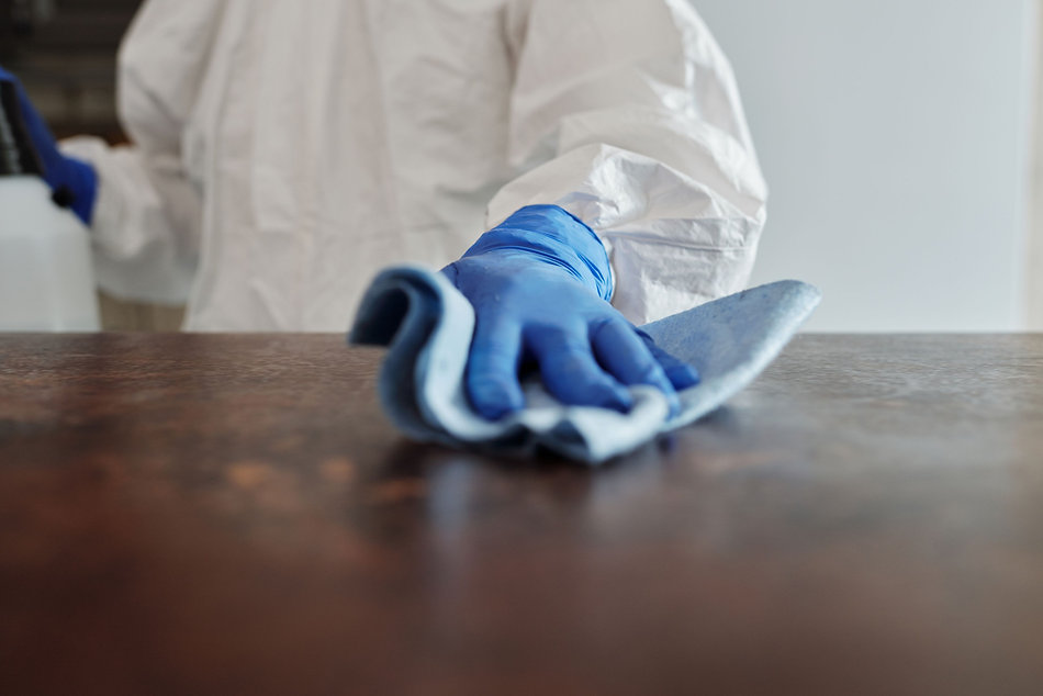 close-up-photo-of-person-cleaning-the-ta