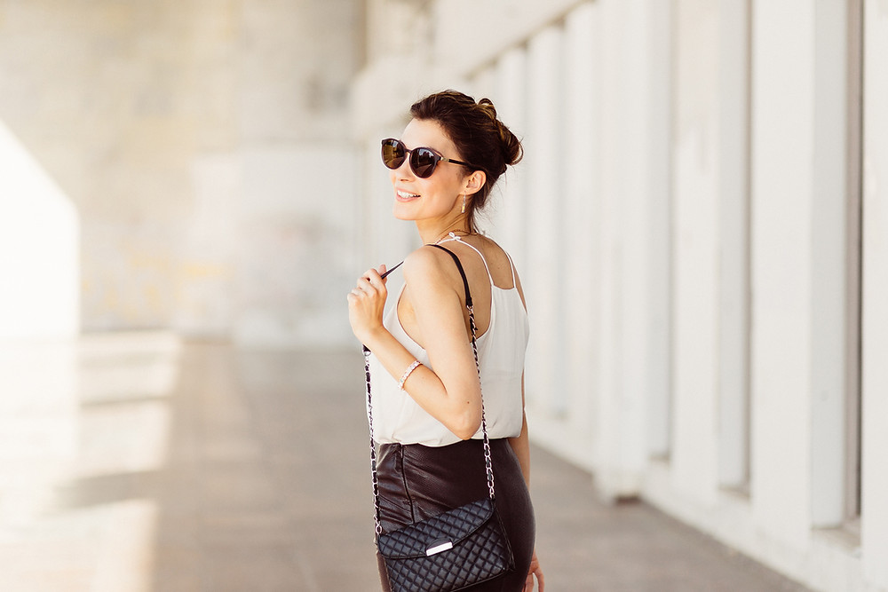 stylish lady in black and white with fashionable purse