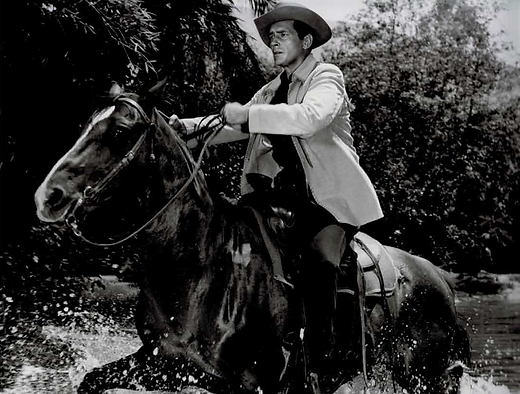 "On the set of ""Maverick,"" Jack Kelly with his horse Goldie in the episode, ""Betrayal."""