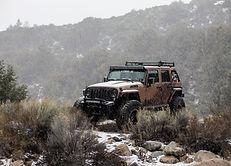 LINE-X Modified Jeep Wrangler on terrain
