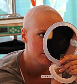 Cancer patient putting on make up
