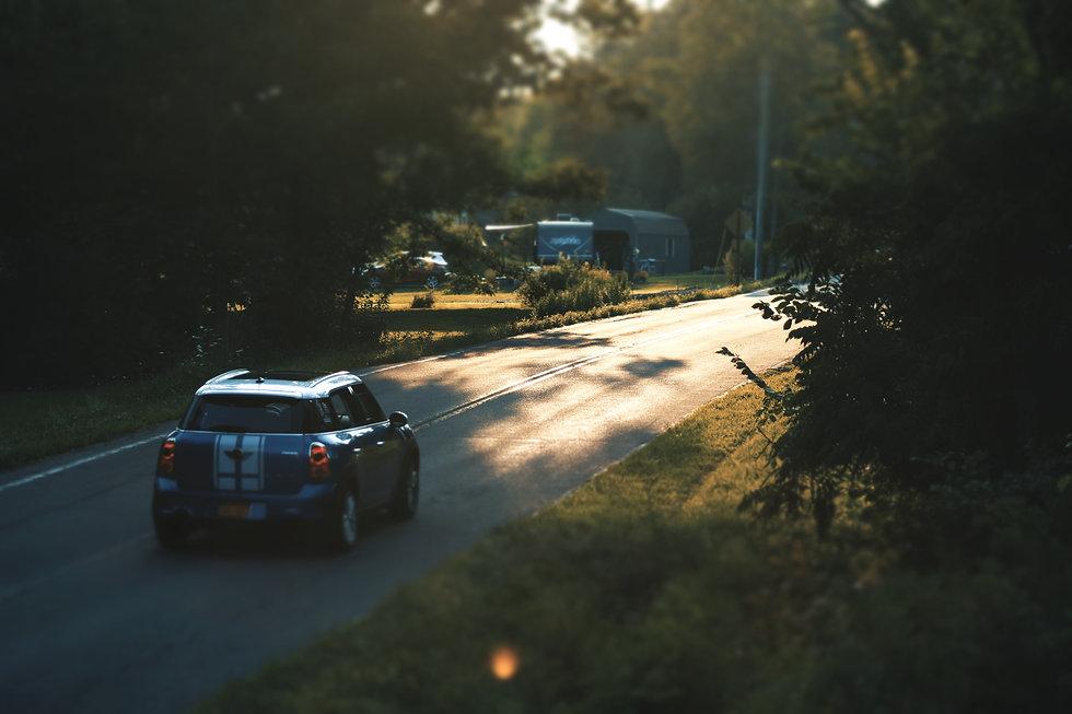 blue-mini-cooper-on-road-1705369.jpg