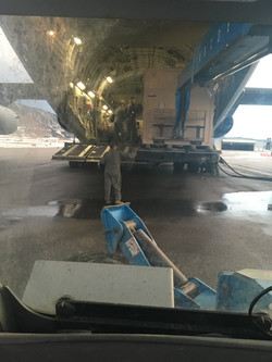 Unloading cargo container from C-17