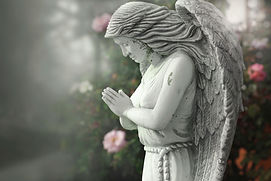 An angel statue in a cemetery