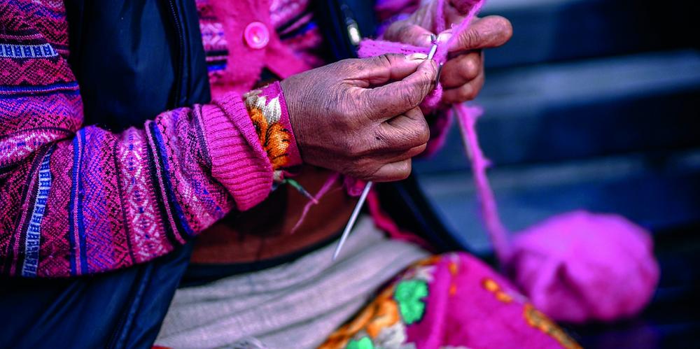 bright pink knitting woman