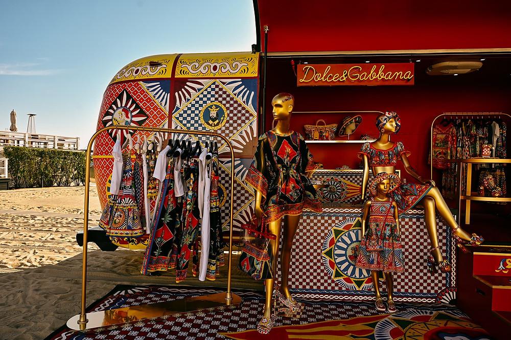 mannequins trailer vibrant prints italian fashion clothing accessories shop sign rails