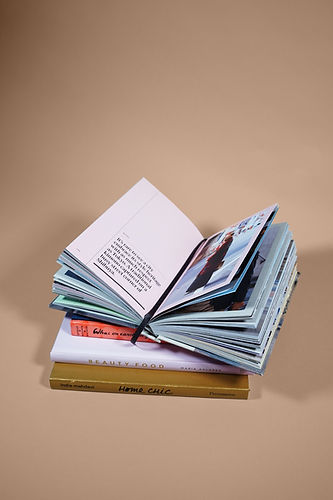 open book on top of several stacked book