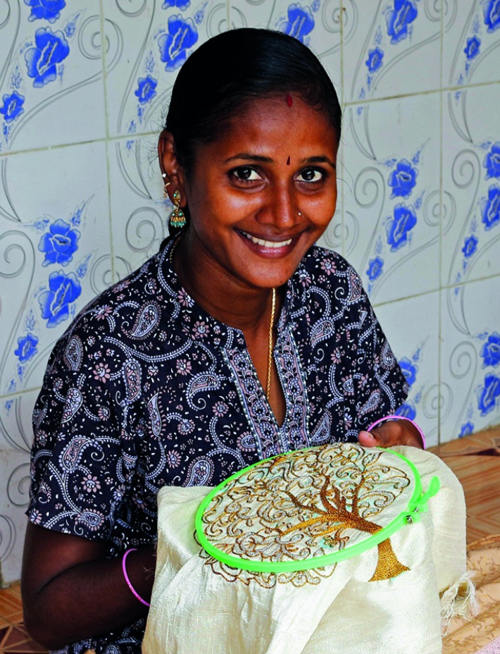 Indian lady doing embroidery