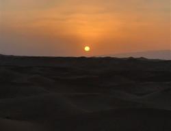Coucher de soleil erg Chegaga désert Maroc.jpg