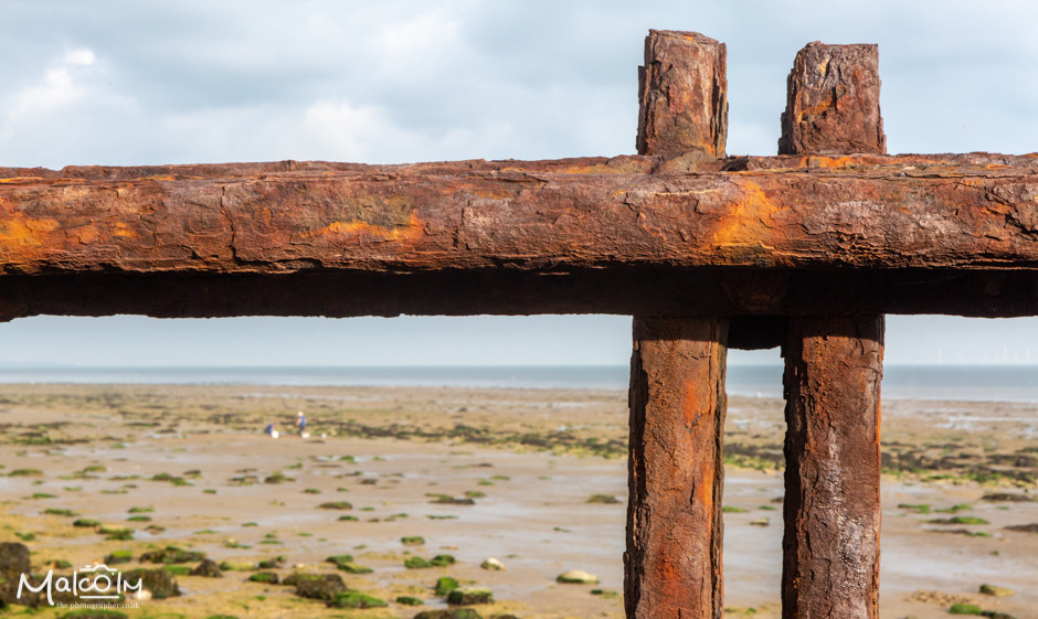 Well rusted iron rails at Reculver Beach