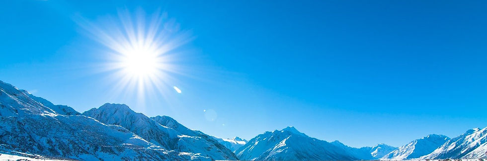 Sun in blue sky and mountains 2.jpg