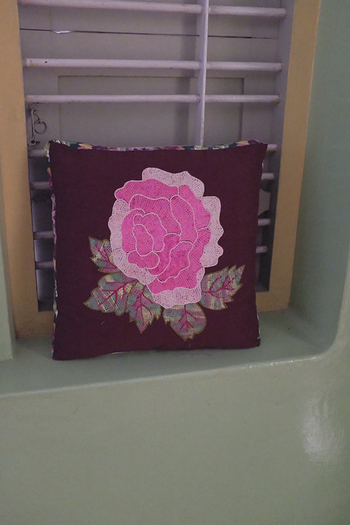 A cushion with rose on it