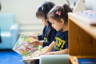 2 casa girls reading 2.jpg
