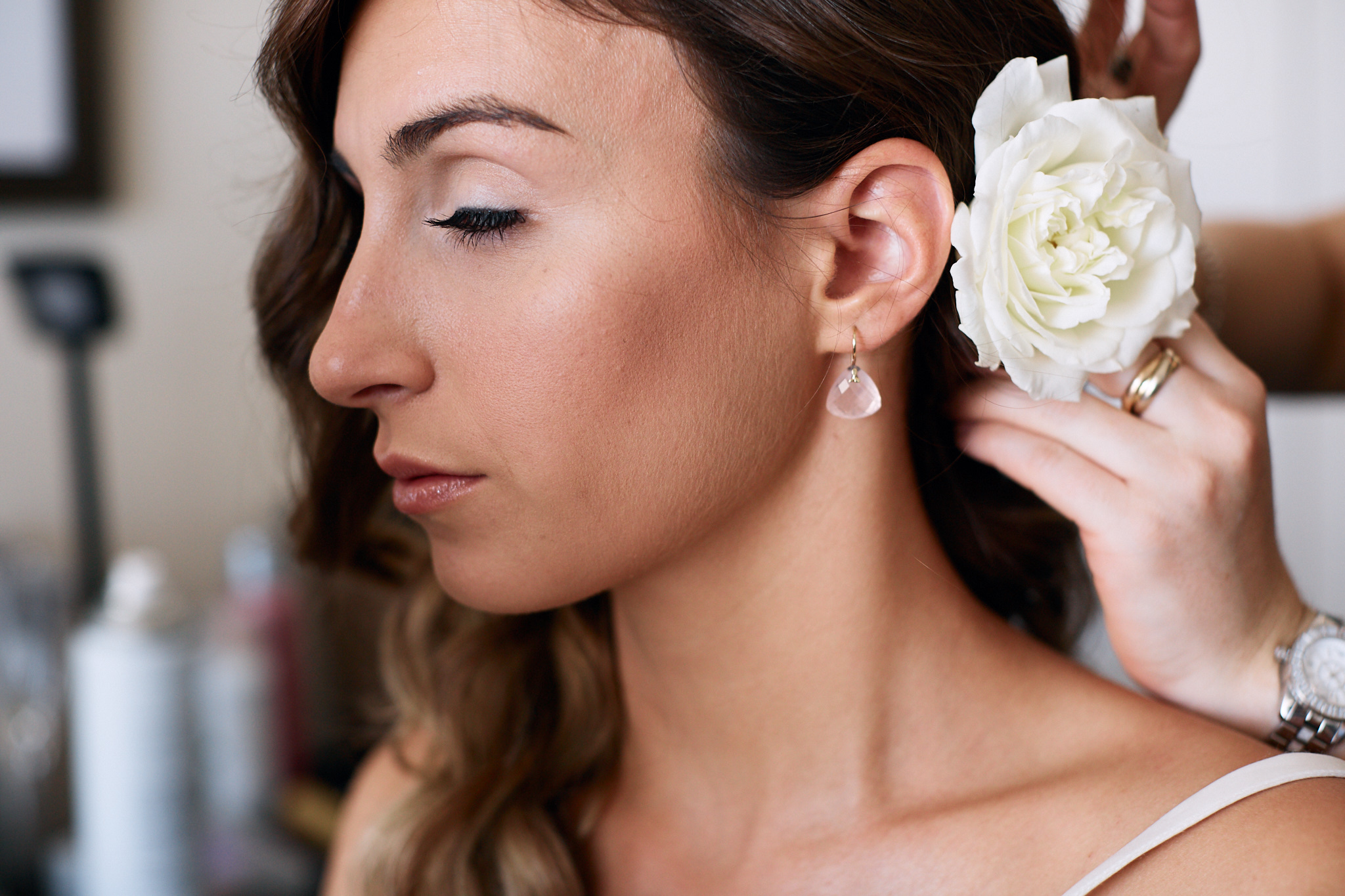 bride earing and flower in hair