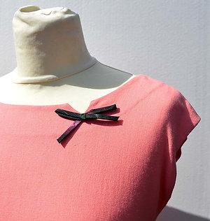 Rosa fodralklänning