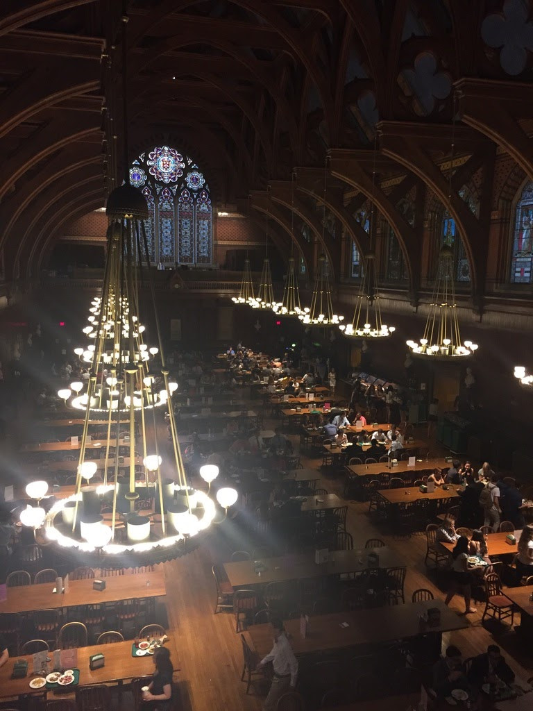 Taken from the second level of Annenberg, with several students pictured eating lunch on the lower level.