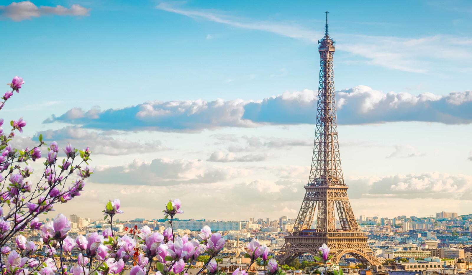 Canva - Eiffel Tour and Paris Cityscape.