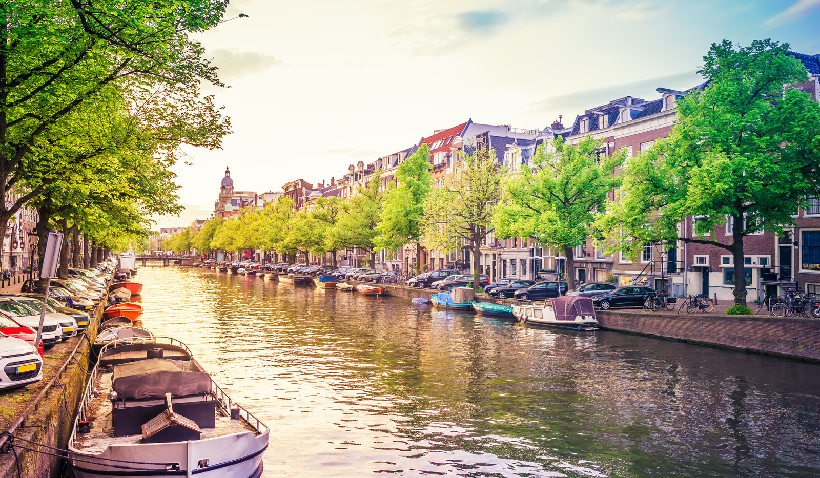 Canva - Channel in Amsterdam at sunset.j