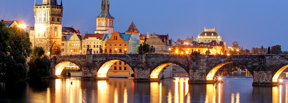 Canva - Prague bridge at night.jpg