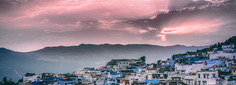 Canva - Santorini under Pink Skies .jpg
