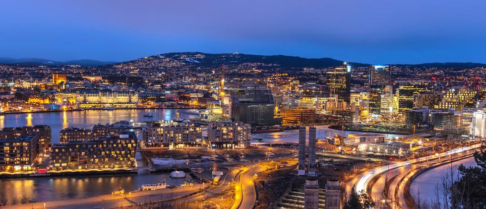 Canva - Oslo night aerial view city skyl
