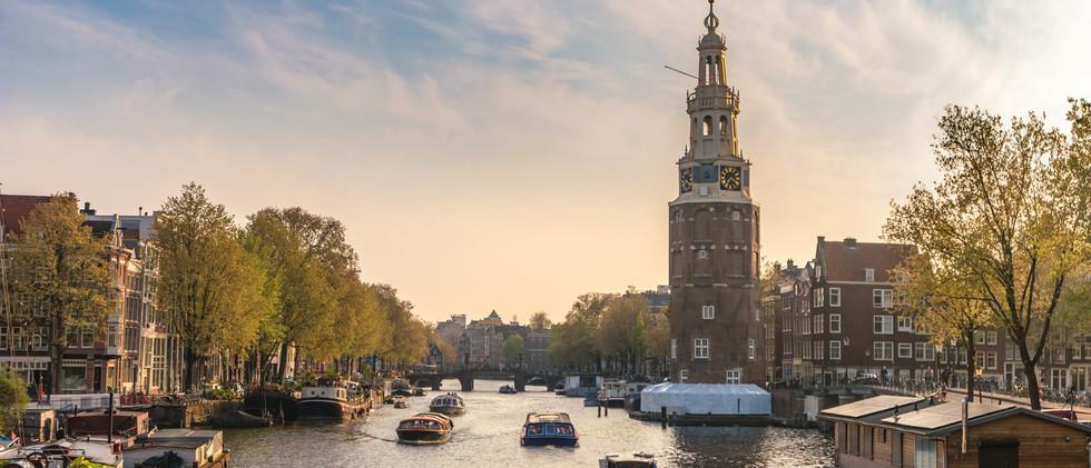 Canva - Amsterdam sunset city skyline at