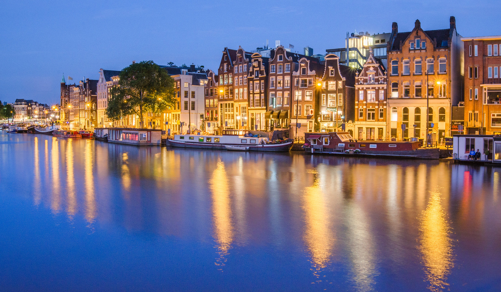 Canva - Houses and Amstel canal at night