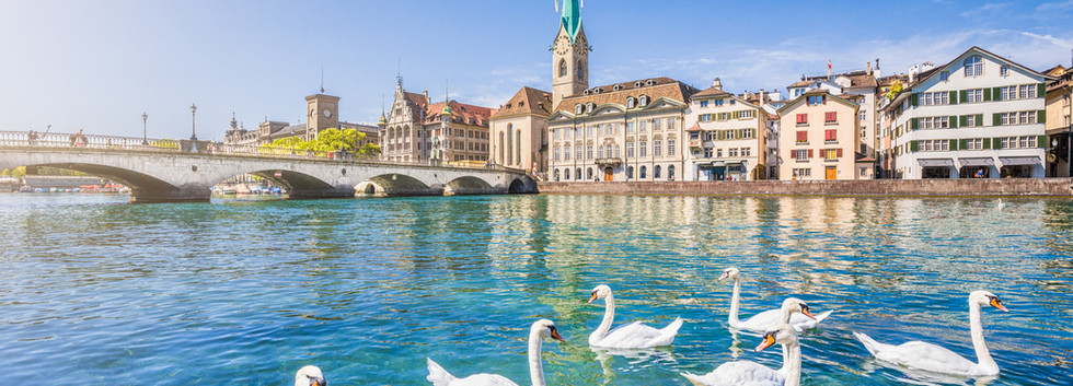 Canva - Historic city of Zurich with riv