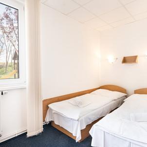 Třílužkový pokoj Penzionu Kovács