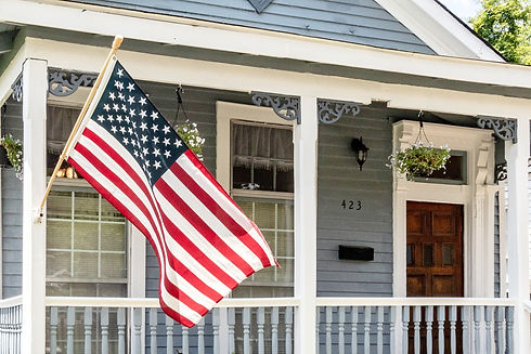 american-flag-blue-white-house-front-porch-historic-home-columbus-georgia-vacation-rental