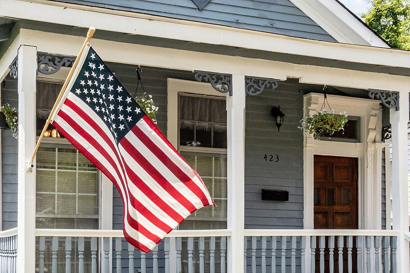 american-flag-blue-house-patriot-family-homes