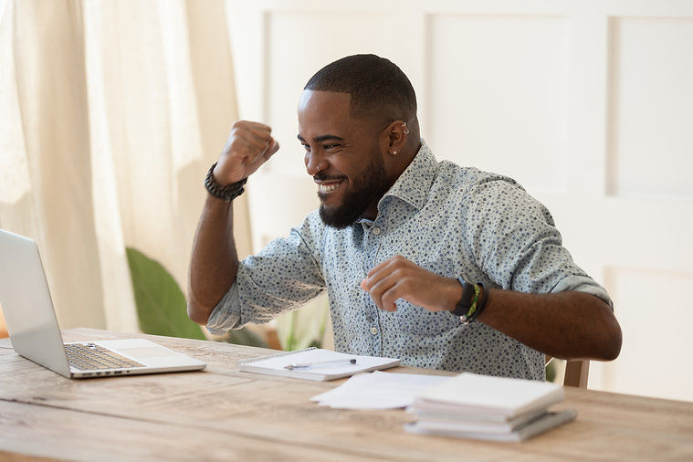 Euphoric young black man celebrating online lottery win, excellent educational online cour
