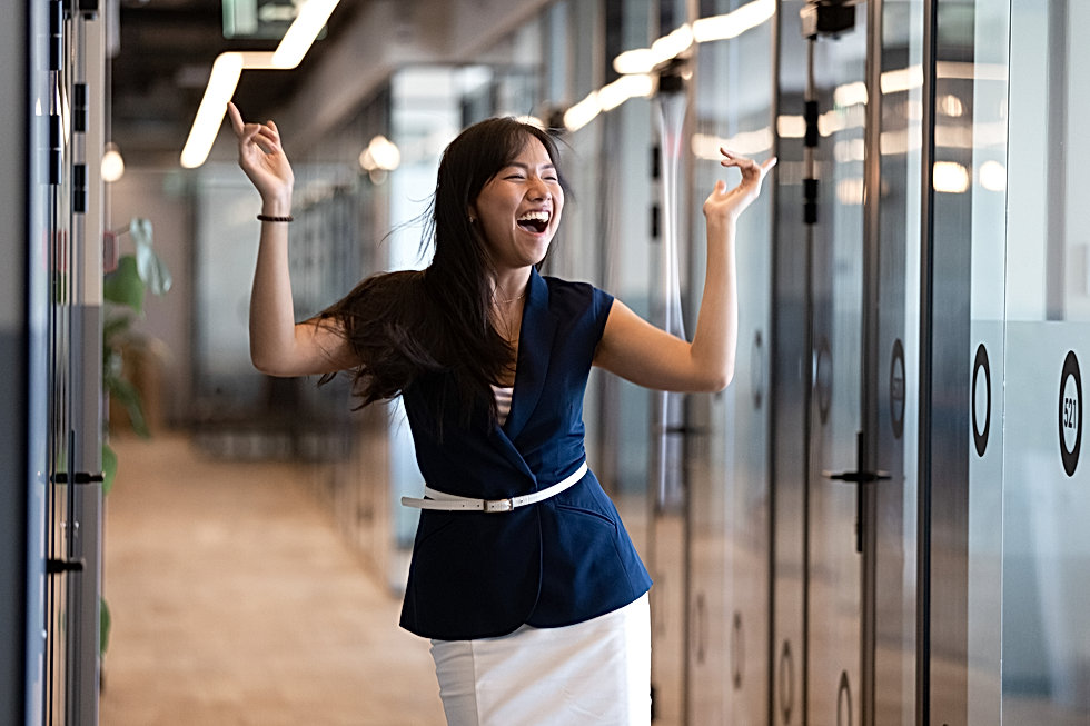 Excited funny young asian business woman