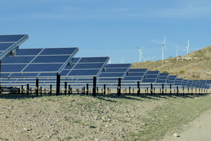As California ramps up renewable energy, utility companies are looking to batteries to solve a supply-demand mismatch, storing excess solar power and feeding it as needed to the grid. Here, a solar farm and wind turbines in Palm Springs, Calif. Credit: Moment Editorial/Getty Images