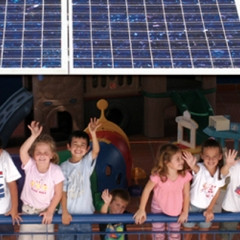 Students under solar panels