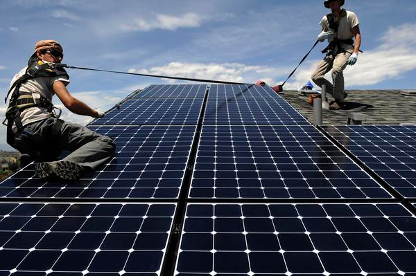 solar installers installing solar panels
