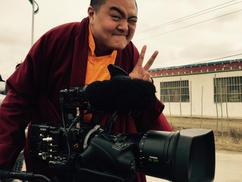 Living Buddha taking a turn at the camera