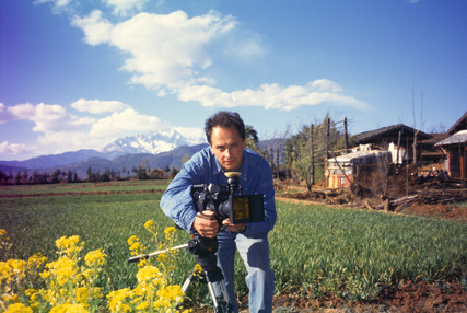 Filming below Yulong Snow Mountain during our return to Lijiang for the 1996 earthquake