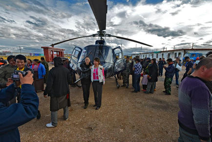 Causing a stir on the Plateau - the first helicopter here