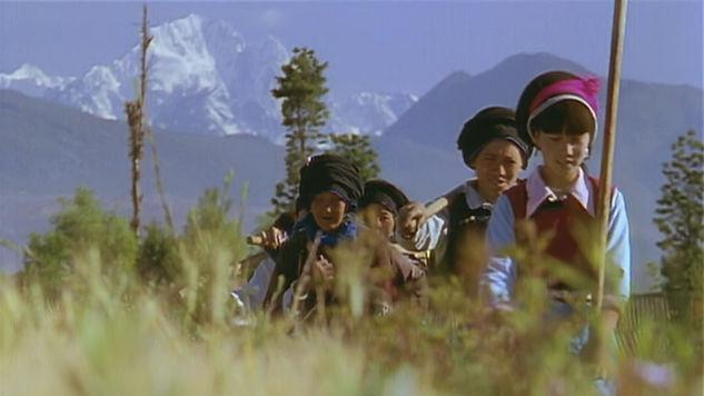 Bai minority in Heqing with distant Yulong Mountain