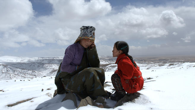 Littel Gama's mother and sister, Qulamu phoning Gama far away in the Wumingsi Monastery