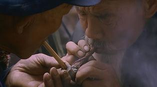 Smoking tobacco in Heqing market
