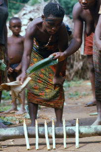Keeping vigil over the bloodied stakes that Jengi has 'killed' the young men with