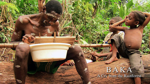 Babu mourning the death of little Akade, playing his improvised guitar