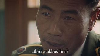 Inspector Zhang investigating the murder of Mr Mu's nephew