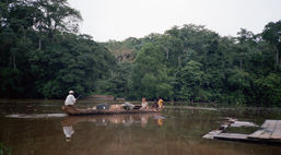 Ferrying gear by dugout across the Boumba river