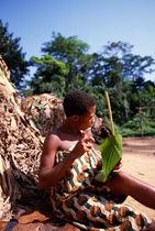 Deni playing a Lingbidi, the leaf harp