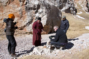 Jon Walker, Huang Fan, Zha La and Zhou Jia setting up remote cameras for Snow Leopards