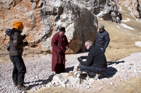 Jon Walker, Huang Fan, Zha La and Zhou Jia setting up remote cameras for Snow Leopards